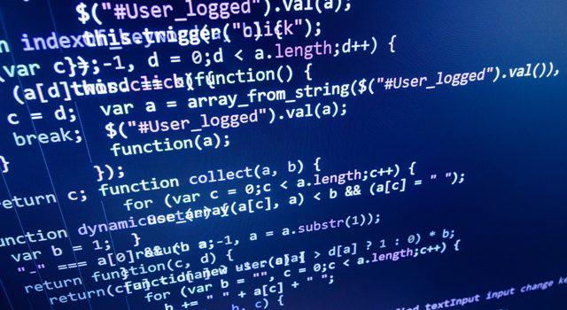 Programmer-software-developer-programming-code-on-computer